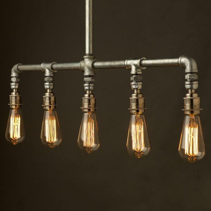 Vintage Galvanised Plumbing Pipe Chandelier. This light fitting can be used to light up a table or bar or just as a ceiling light feature.