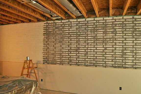 Poured basement painted to look like brick basement for Poured concrete basement walls