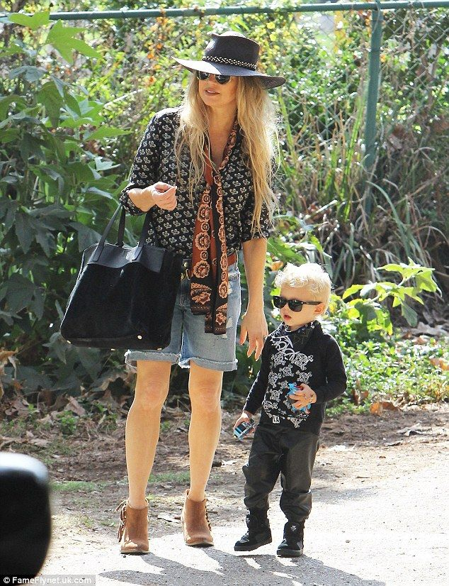 Fresh as a daisy: Fergie couldn't wait to take her adorable son Axl to the park on Thursday after flying in on a red eye from New York