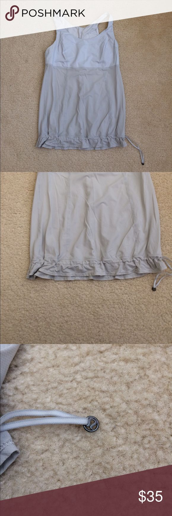 Lululemon loose-fit tank Lululemon tank • loose-fit • drawstring hem • gray bodice • blue striped bust area • Sz 10 • stain on back • great overall condition • fast same/next day shipping • BUNDLE & BUY IT NOW!!! lululemon athletica Tops Tank Tops