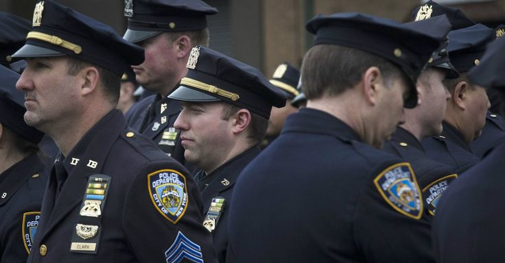 Thousands of NYPD officers filled the streets on a rainy Sunday morning outside a Brooklyn funeral home to pay their respects to Wenjian Liu.
