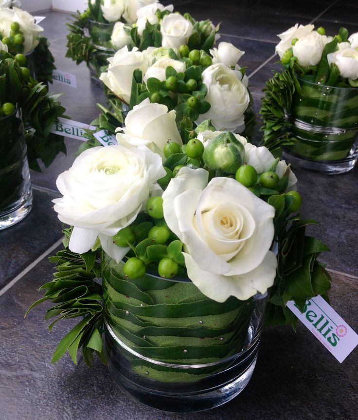 Modern table flower arrangement - white roses and St. John's wort