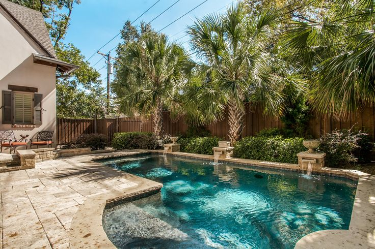 Palm trees & a crystal clear pool, like this one in University Park, TX, is a pretty perfect combo.