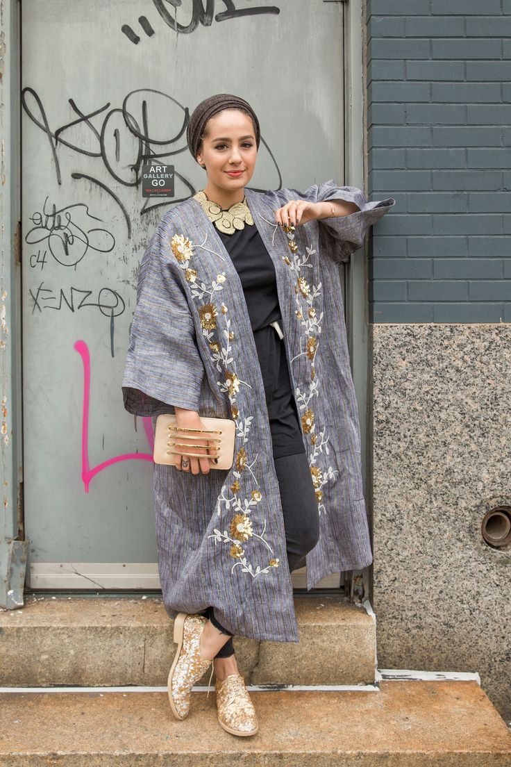 """The Kuwaiti fashion blogger is wearing a modern take on the bisht. """"I love to stand out,"""" she says. """"Because it's a Middle Eastern designer, I think it stands out a bit more.""""   - Cosmopolitan.com"""