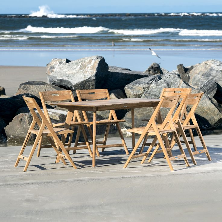 Surf 7PC Dining Set  Generously scaled and visually robust, the chairs are relatively lightweight yet structurally strong given their solid teak stature. The Surf Table draws inspiration from Scandinavian architecture, lending it a light and airy appearance. Its irresistibly smooth tabletop makes it an excellent choice for the indoors, though it is more than robust to endure the test of time and the outdoors.