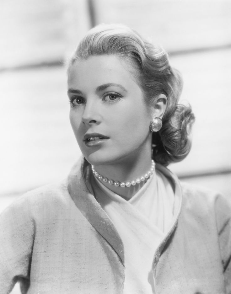 The first time I ever noticed Grace Kelly was in Hitchcock's Rear Window. Her first scene entrance had my jaw on the floor! If she were at my dinner table, I would probably be wearing a bib to catch my slobber and be totally speechless.