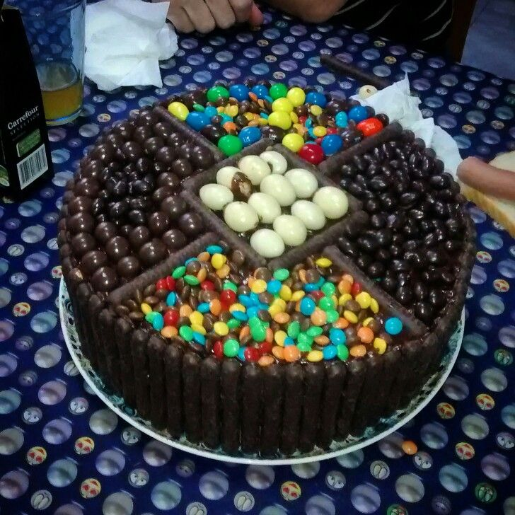 Chocokate cake, with many many candy. Later the picture of the cake cut to see the inside