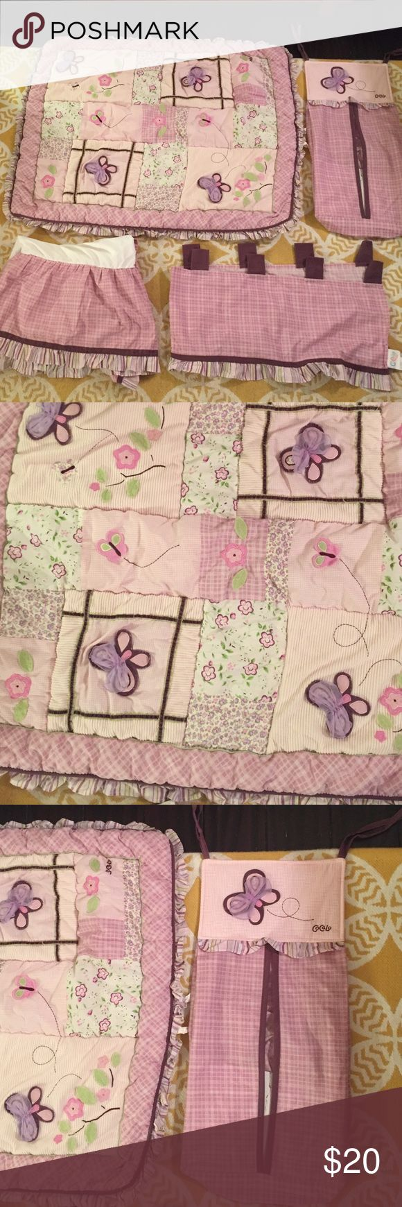 4 piece baby girl crib set! Gently used baby girl crib/room set. Pink and purple. Has plaid, patchwork design with flowers, butterflies, and ruffles. Comes with crib skirt, blanket, window covering, and hanging clothes bin. In good used condition. Other