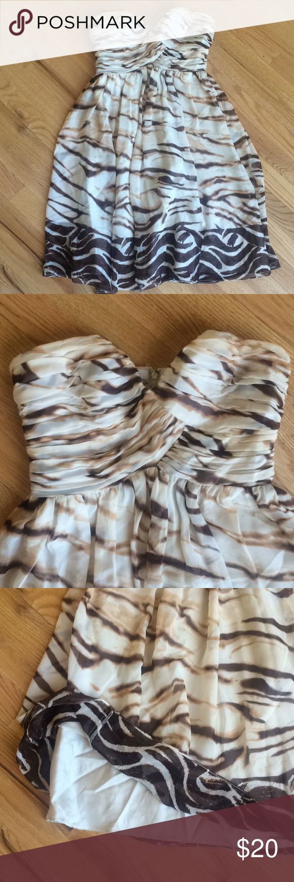 Tan Printed Silk Dress size 2 The perfect wedding guest dress made to dance all night 100% Silk Tan and brown shades Beautiful sweetheart neckline  Comes down to above the knee, depending on height   Size: 2 Condition: EUC Donna Morgan Dresses Strapless
