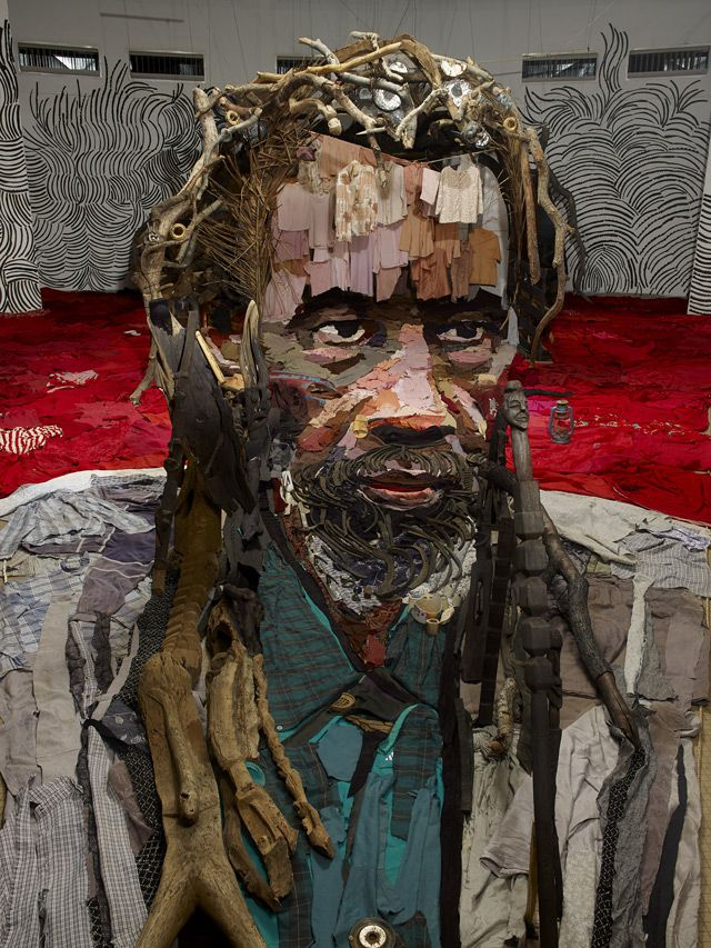 Anamorposisisan illusion wherea specific vantage point is needed for the image to come together. French artistBernard Prashas made an art ofassemblage. This,his latest piece, is a portrait of Malian actorSotigui Kouyaté.  You can see it is composed of clothes, paint, wood, rubber, and other objects scraped together.  Its only when seen through his camera that the portrait comes together.