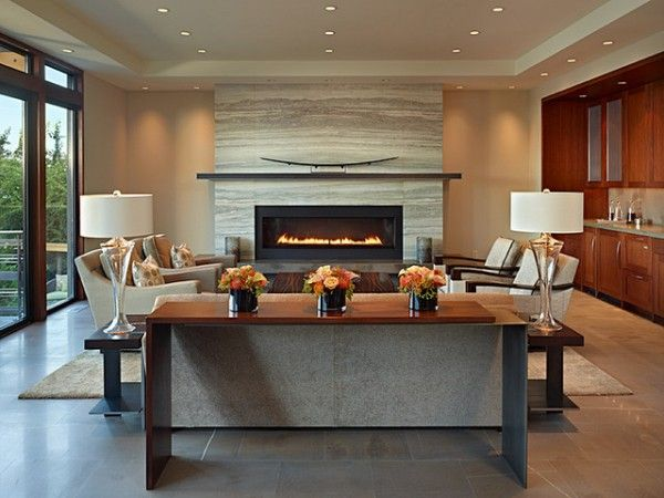 How about a wider fireplace but not as tall - allows mantle to be placed lower on wall above raised hearth seating.