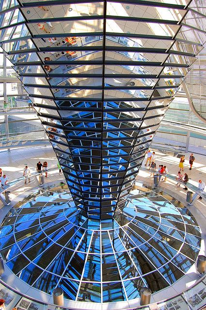 "Norman Foster, ""Reichstag Dome"", 1999, a glass dome constructed on top of the rebuilt Reichstag building, symbolizing the reunification of Germany.  A mirrored cone in the center of the dome directs sunlight into the building, so that visitors can see the working of the chamber, Berlin, Germany."