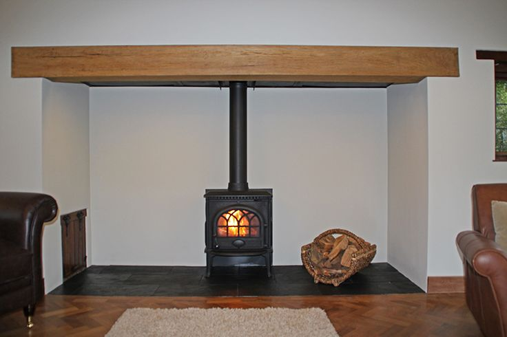 Completely redesigned and rebuilt mock Tudor inglenook fireplace with Jotul F3 wood stove and slate tiled hearth, installed in Hockley Essex 2012 Scarlett @ Design a fireplace