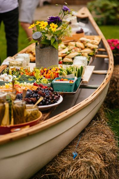 A delightful and functional display idea from Simple Bites: present your outdoor buffet in an old canoe, accented with pretty wildflowers.