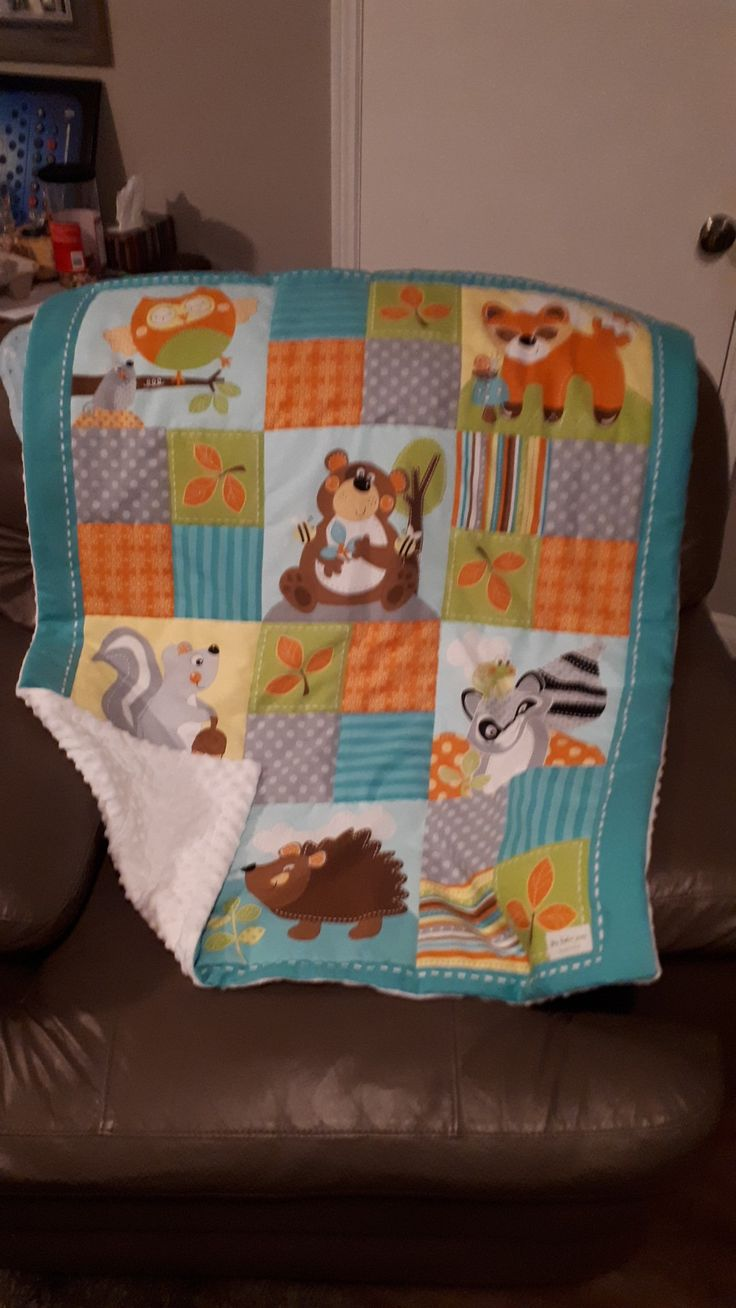 Woodland creature blanket with white minky on the back sewn by 'this baker sews'