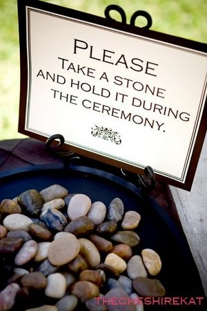 """""""Unity ceremony: guests will hold a river rock during the ceremony and may bestow wishes and prayers on it; then they will combine them together and use them as decor in their house. """""""