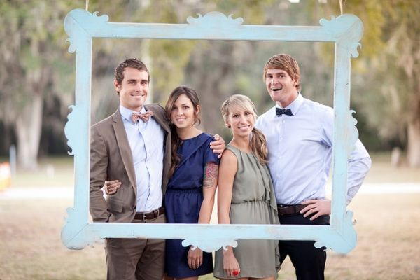 Backyard party idea....hang picture frame from tree so guests can take pics