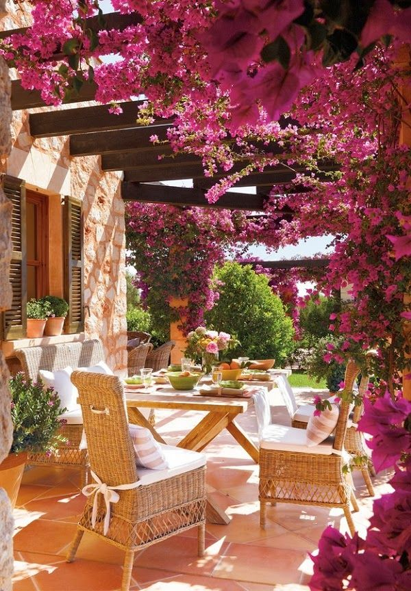 Bougainvillea covered arbor over an outdoor dining area/patio terrace... Some Flowery Inspirations for Spring