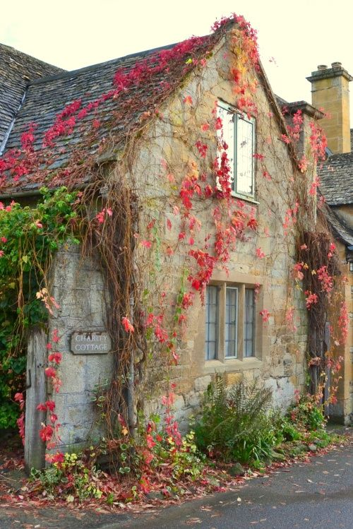 """Charity Cottage, Stanton"" Wrapped in the colours of autumn. A picture of: Stanton, Gloucestershire (Photographer: © Martin Humphreys / Pictures Of England)"