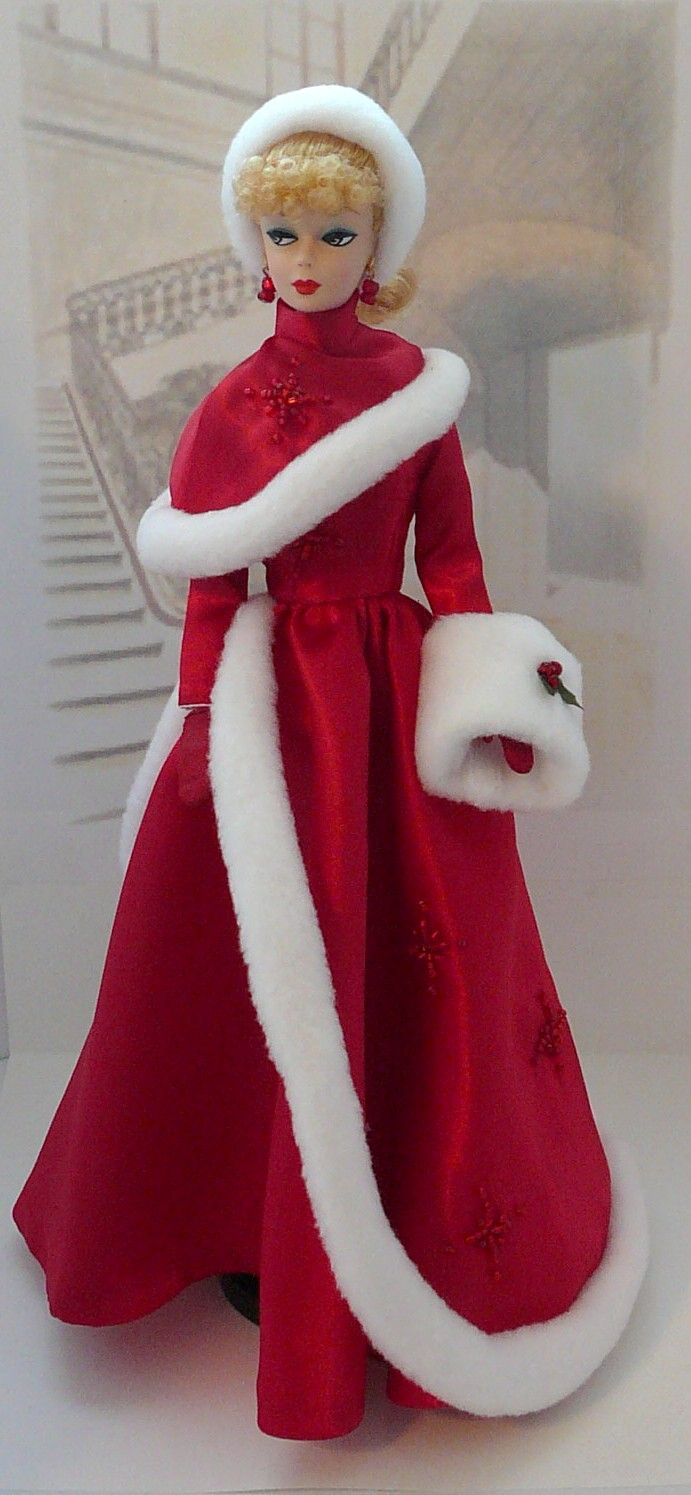 Christmas Barbie in red gown with fur trimmed coat