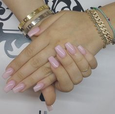 Short acrylic nails. Natural color nails