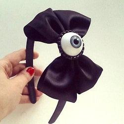 Creepy cute eyeball bow headband