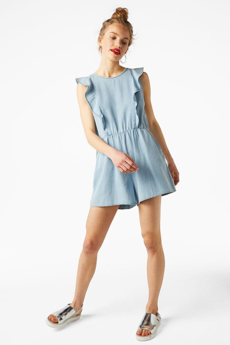 A 100% cotton playsuit made especially for frill seekers. With two side pockets, two ruffles in front and two more framing a keyhole back.