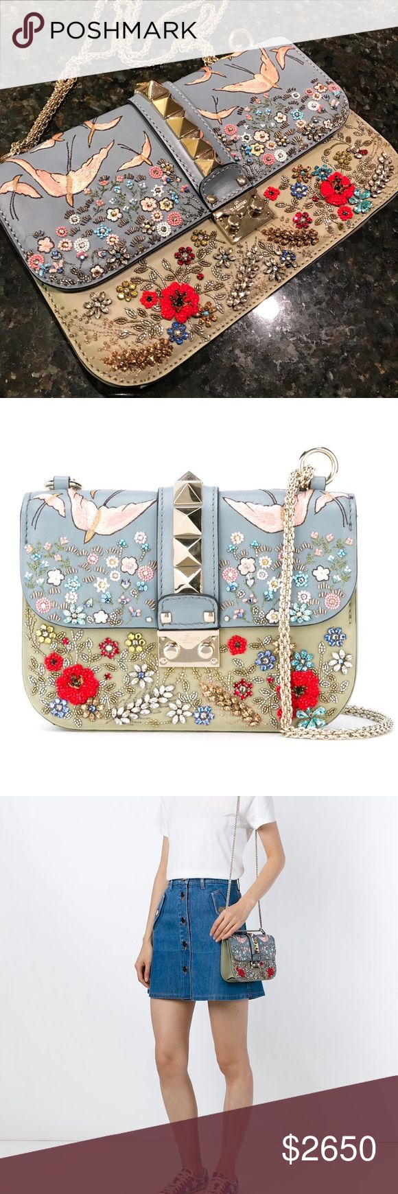 """Valentino Rocklock """"glam lock"""" embroidered bag Multicoloured lambskin 'Glam Lock' embroidered shoulder bag from Valentino Garavani featuring a foldover top with push-lock closure, gold-tone Rockstud embellishments, a gold-tone chain shoulder strap, an internal zipped pocket and an internal logo patch. Made in Italy Product Strap: 12.6 in Depth: 2.4 in Width: 7.9 in Height: 5.9 in Sample sale, pen mark on the label. Missing 3 gems but does not affect overall looks, other than that In new…"""