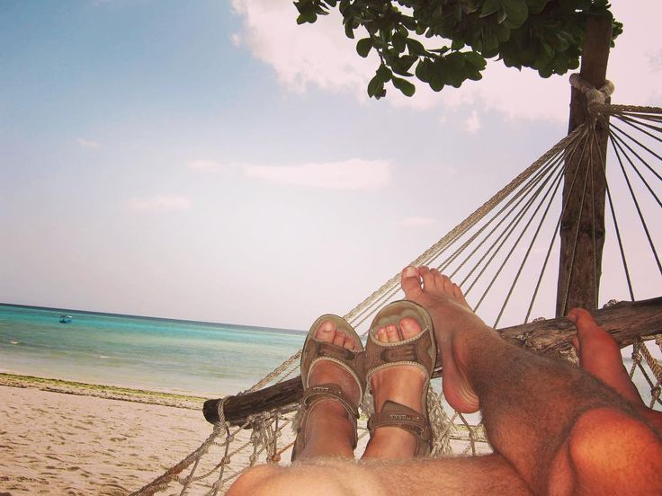 Put your feet up in the tropical paradise that is #Zanzibar. Relax with a cold cocktail and watch the palm trees sway in the breeze.   To visit Zanzibar check out our website www.wildfrontiers.com or email us!   #island #paradise #africa #WildFrontiers #islandliving