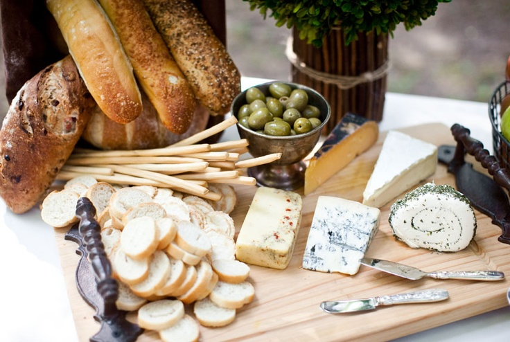 """Guests are always looking to munch while mingling with other partygoers. Welcome them with a snack—like a rustic cheese board—as they arrive. Wilson's favorite three cheeses: blue cheese, apricot Stilton, and pepper-crusted Brie. """"I serve them with a fresh sliced baguette, dried cranberries and apricots and cashews. I also love including an organic honey to compliment the blue cheese,"""" Wilson said."""