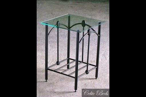 The Lagan wrought iron table has a traditional, almost antique design.