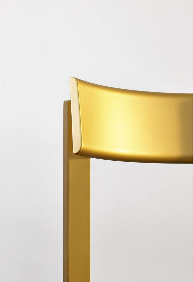 The chair, which is designed for home environments as well as public spaces, comes in beechwood as well as black lacquered and gold finishes. There's also an upholstered version of the chair made from solid oak.