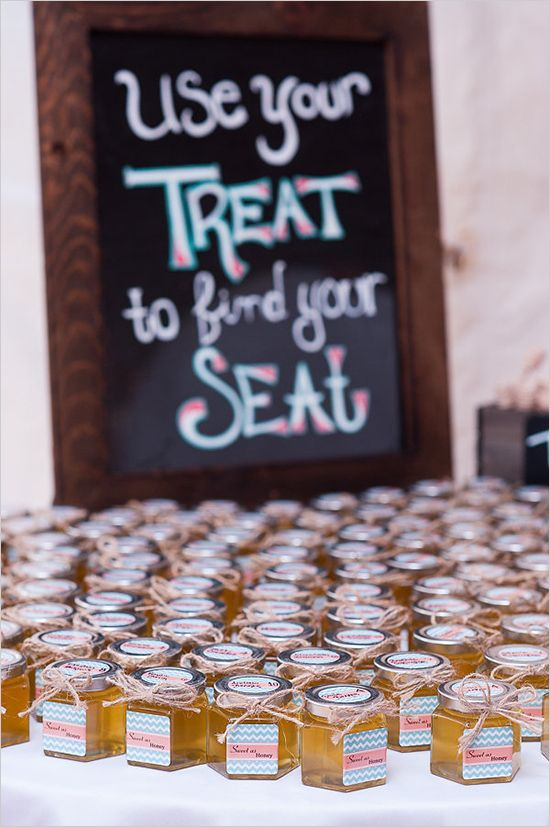 Honey jars double as wedding favors and table numbers@weddingchicks