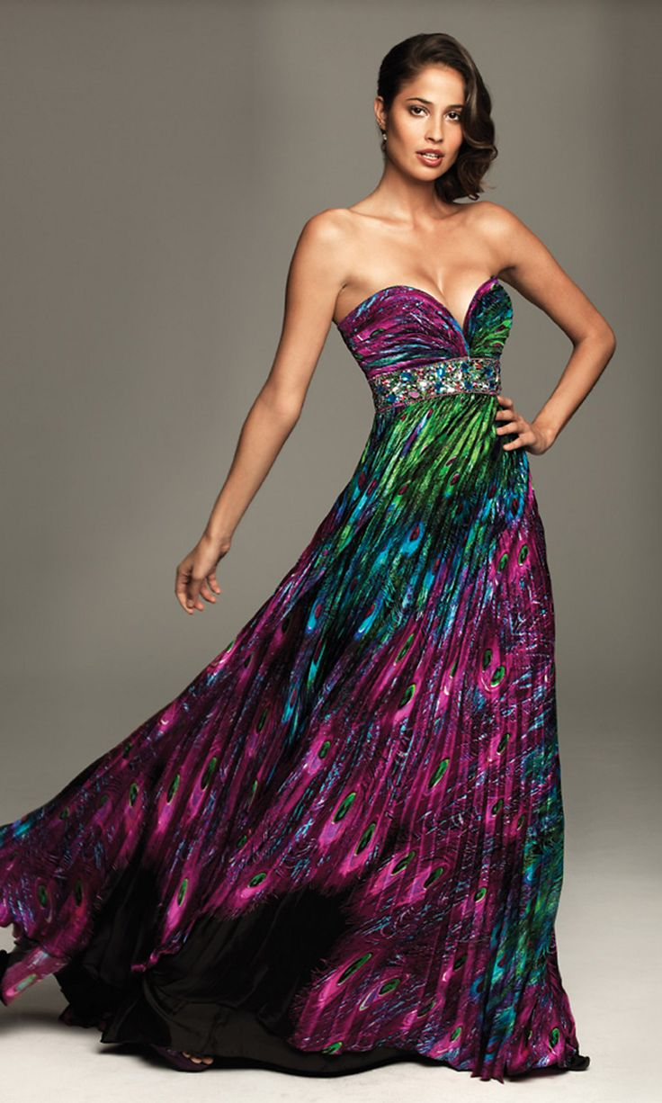 Strapless Peacock Print Dress by Night Moves, NM-A401, $378. A colorful sexy strapless evening gown featuring a sweetheart bodice with sparkling stones on the empire waist. A multi colored peacock print on the pleated floor length skirt makes this a perfect dress for the girl who wants to be noticed. Details: Charmeuse, Zipper closure, Floor Length, Strapless Sweetheart, Empire Waistline.