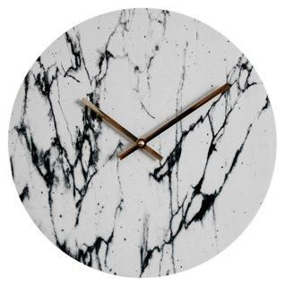 11 Inch Black and White Marbleized Modern Wall Clock -- Crafted of cherrywood sourced in the USA, this hand-printed clock features a white marble motif that pops against the brass hands. Lifetime warranty on quartz clock mechanism and mounting hardware included.