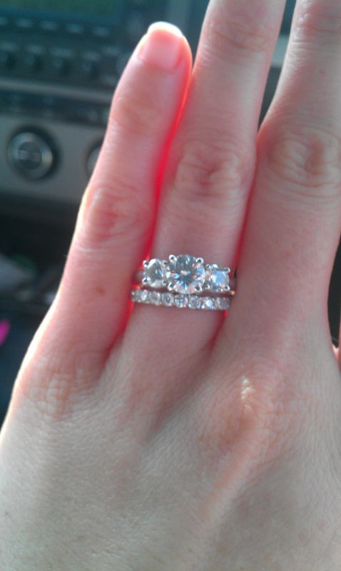 Straight Wedding Band Next To 3 Stone Engagement Ring