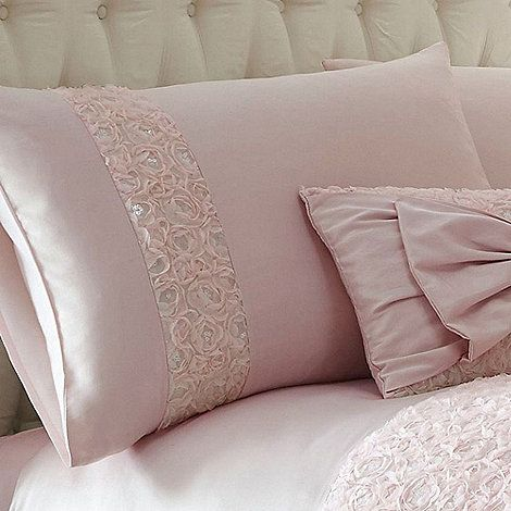 Perfect for making a glamorous statement, this pink pillow case pair is designed by Julien Macdonald and celebrates his signature feminine style.