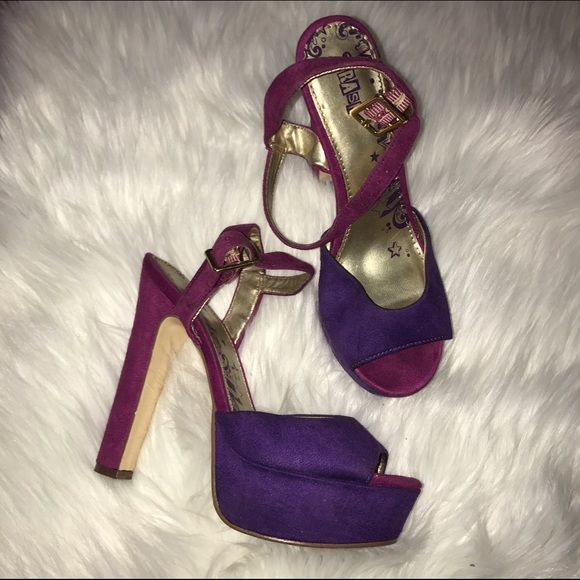 Two Tone Pumps Super Awesome and funky two toned heels!! ( pink & purple ) The heel of this shoe is thick & supportive, super comfy to walk in (in my opinion).. In good used condition. Suede material. A few signs of wear!* Shoes Platforms