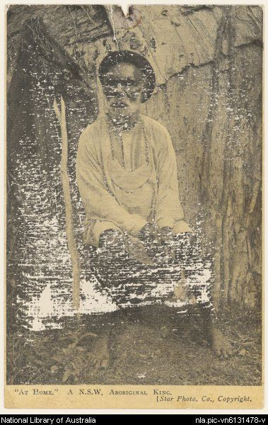 Aboriginal man in European clothing wearing a king plate and sitting outside a bark shelter, New South Wales, ca. 1890 [picture]