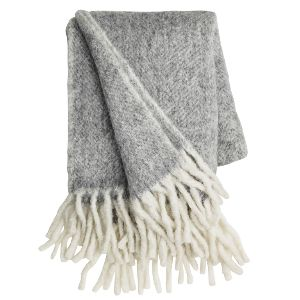 Cozy Living Grey Mohair Throw: Wool is an ancient natural material used by Northerners to provide warmth. These Cozy Living throws have a beautiful characteristic herringbone pattern. They are elegant, very soft as well as thick and cozy, perfect to snuggle up with. This soft grey with cream tassels will compliment any space.