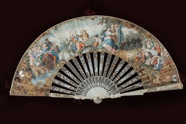 ÉVENTAIL À SYSTÈMES, vers 1750-1760 Éventail de type plié. Feuille en peau peinte à la gouache, montée à l'anglaise. Monture en ivoire repercé, gravé, et partiellement doré. H.t. 24,2 cm H.f. 10,3 cm… - Rouillac - 13/02/2015
