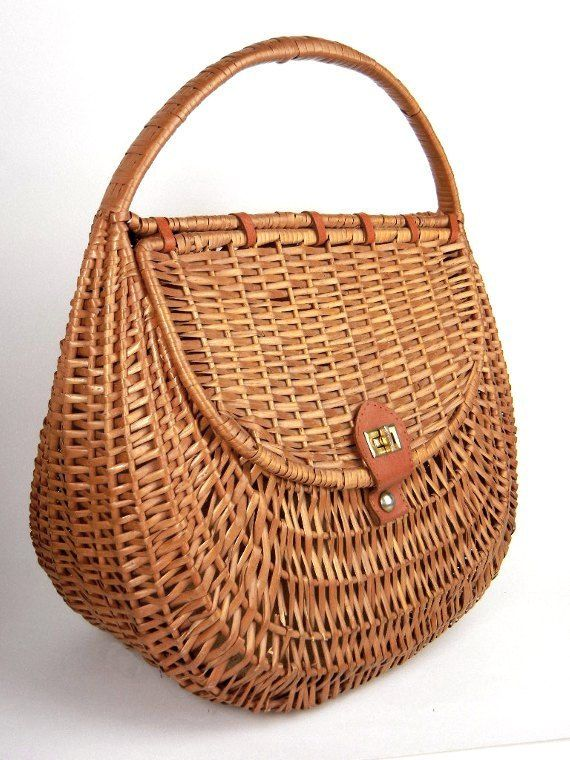Vintage large wicker tote basket handbag purse with handle and leather accents from the 1960s