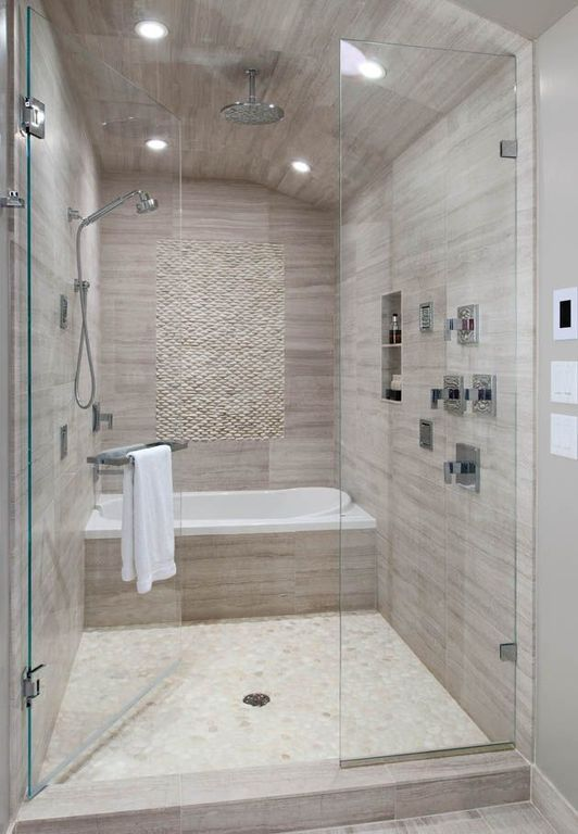 Contemporary Master Bathroom with Waterfall Series Porcelain Tile, High ceiling, Rain Shower Head, frameless showerdoor