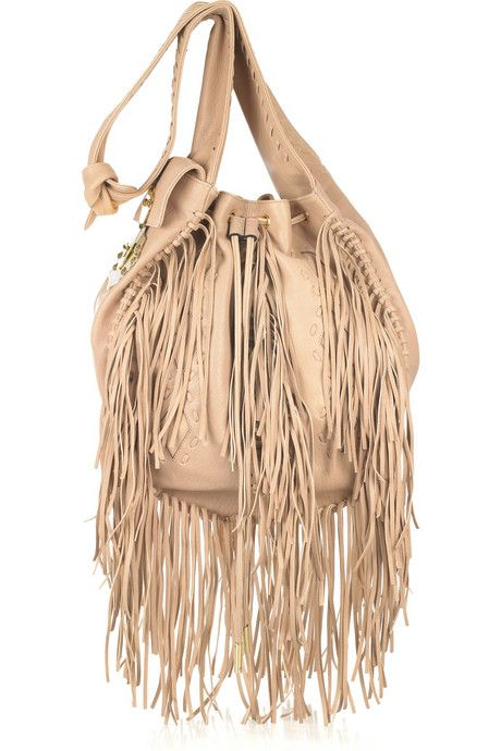 Emilio Pucci Nude fringed leather bag    Emilio Pucci bag has a drawstring fastening at top, diamond cutout details, whipstitch embellishment, a side pouch
