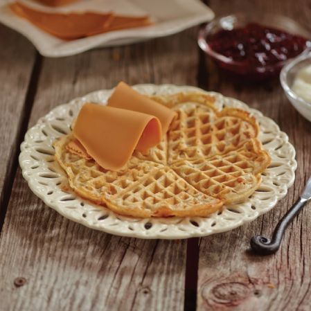 norwegian waffle with ski cheese - a long standing tradition with sour cream and jam