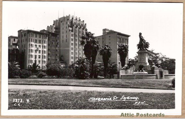 Vintage real photo postcard of the Captain Arthur Phillip statue in the Royal Botanic Gardens in Sydney, New South Wales, Australia. (Macquarie Street, the title of the postcard, is hidden between the shrubs and buildings.) One of the Mowbray Series of 'Scenic and Historic Views' cards.