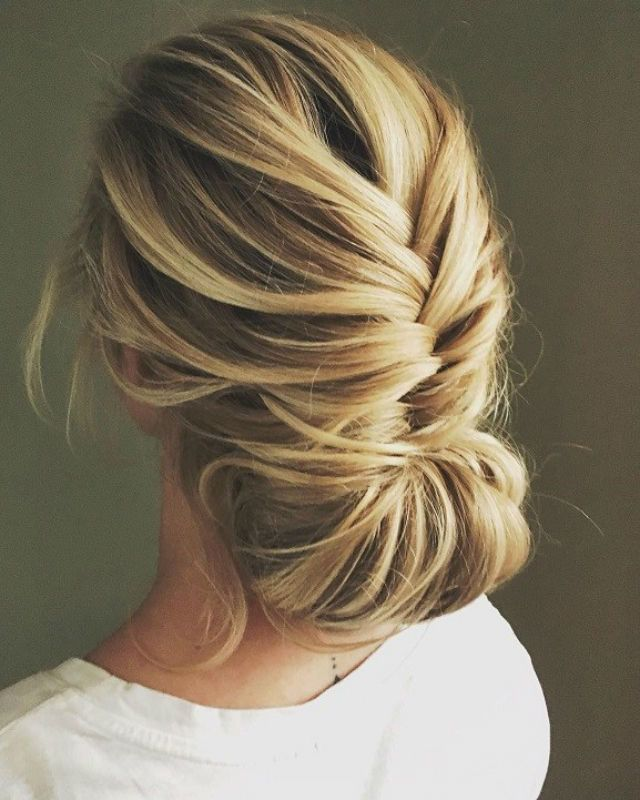 2018 wedding hair trends - braided low set updo
