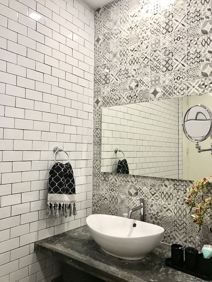 Grey and white bathroom. Traditional subway tile with modern grey mosaic tile and industrial cement sink counter