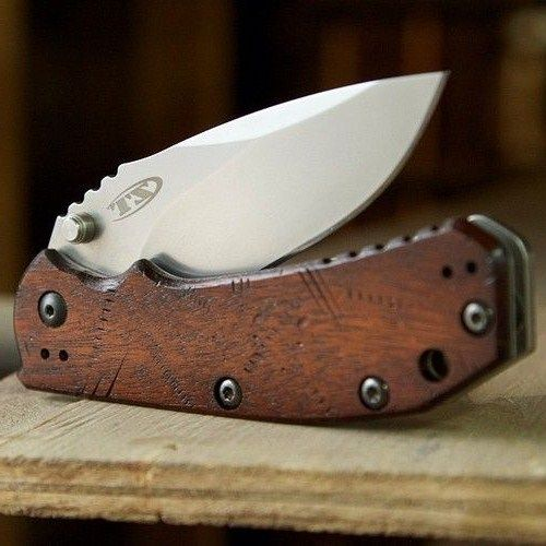 customized pocket knives ZT 0550 by worldofwoodcraft, love the distressed wood scales