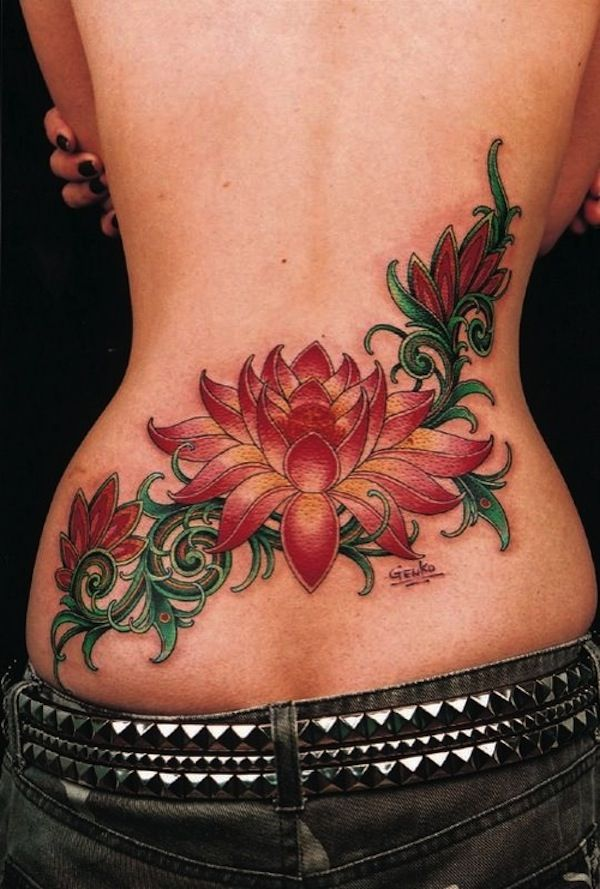 Red lotus flower tattoo on lower back - Lower back seems like the perfect placement for lotus flower tattoo for women. #TattooModels #tattoo